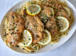 Chicken-Piccata-With-Pasta on a white platter