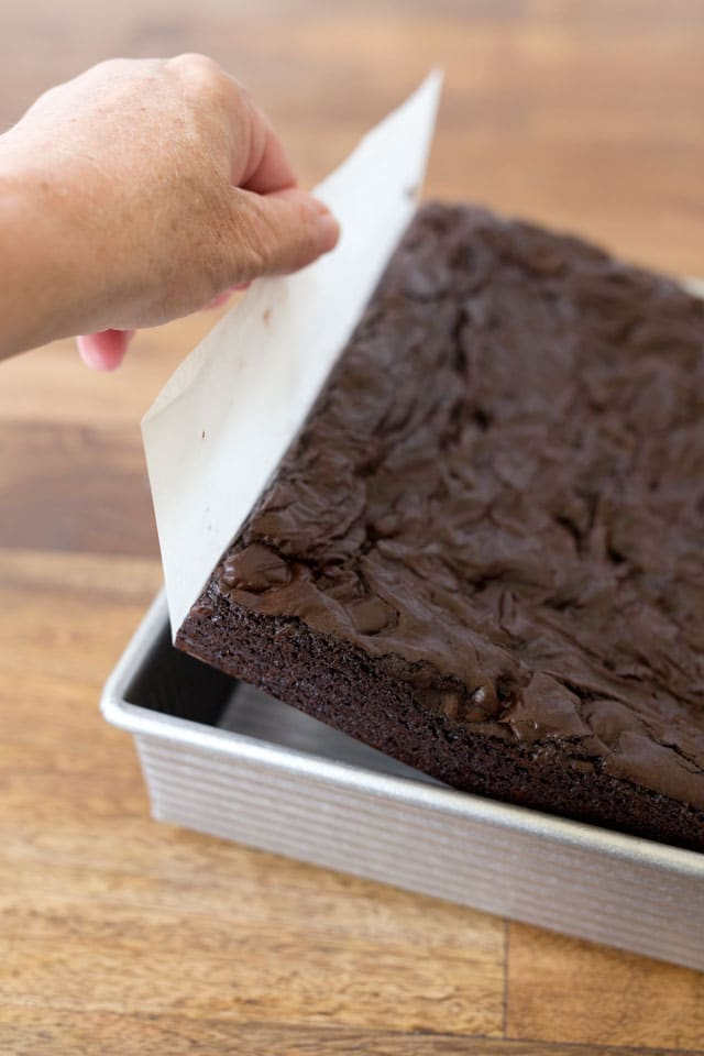 Use parchment paper to easily remove the brownies from the pan.