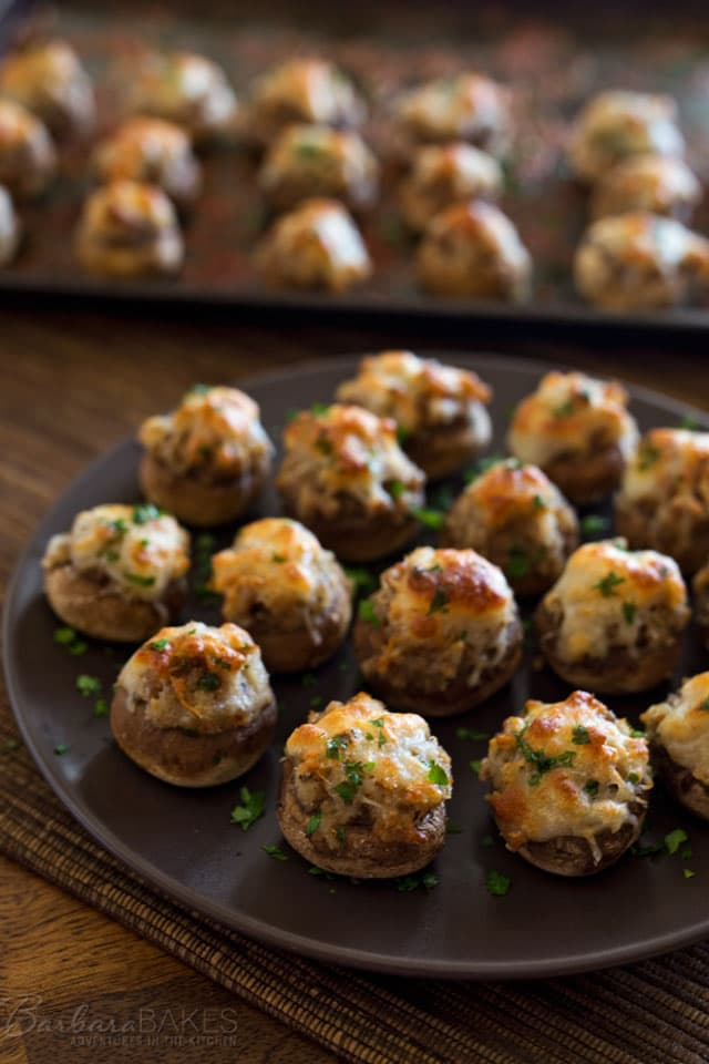 These 6 Cheese Italian Sausage Stuffed Mushrooms are a perfect addition to your next holiday party. Button mushrooms stuffed with sausage and 6 Cheese Italian finely shredded cheese, then baked until they\'re tender and golden brown.