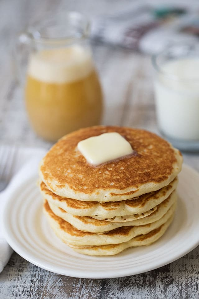 Melt-In-Your-Mouth Buttermilk Pancakes with Buttermilk Syrup that is rich, sweet and buttery. A delicious, sweet way to start the day.