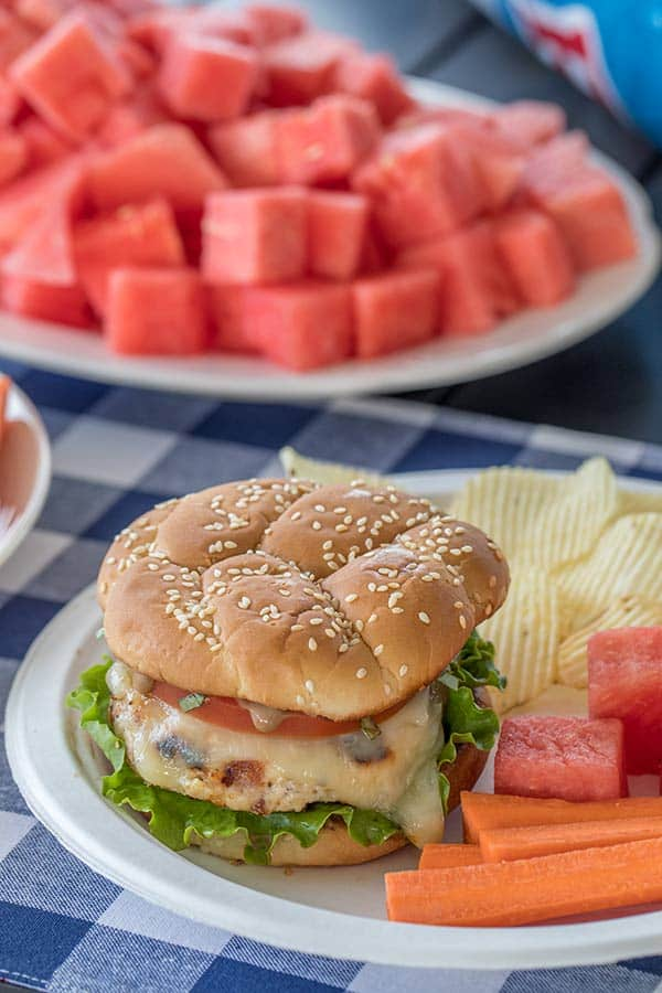 These Chicken Caprese Burgers are the new favorite burger at our house. A grilled chicken burger topped with melty mozzarella, tomato, basil and a flavorful balsamic mayo. It\'s a must try burger this summer.