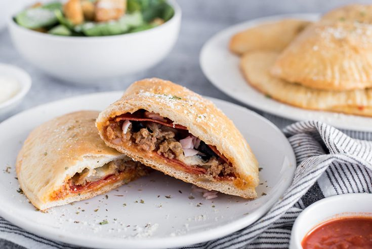 Meat Lovers Calzone cut open on a plate