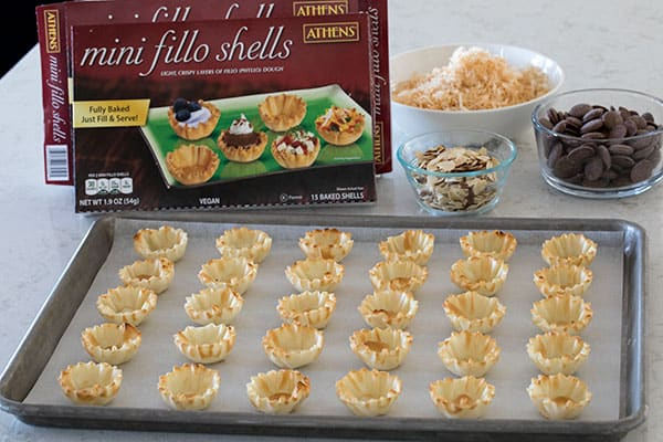 mini fillo shells on a baking sheet, ready to be filled with coconut pie filling