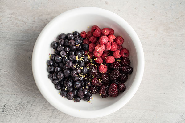 Bowl of berries and lemon zest