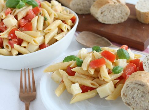 Pasta Caprese on a white plate