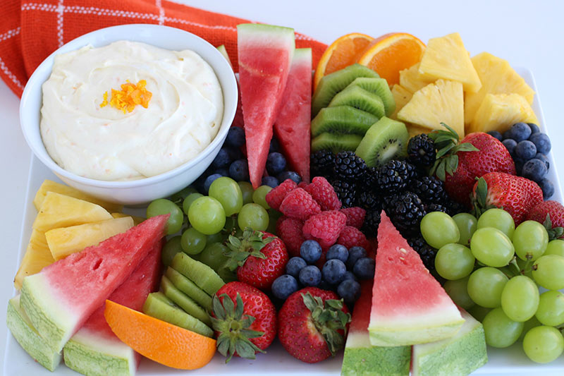 Creamy Orange Fruit Dip with sliced fruit