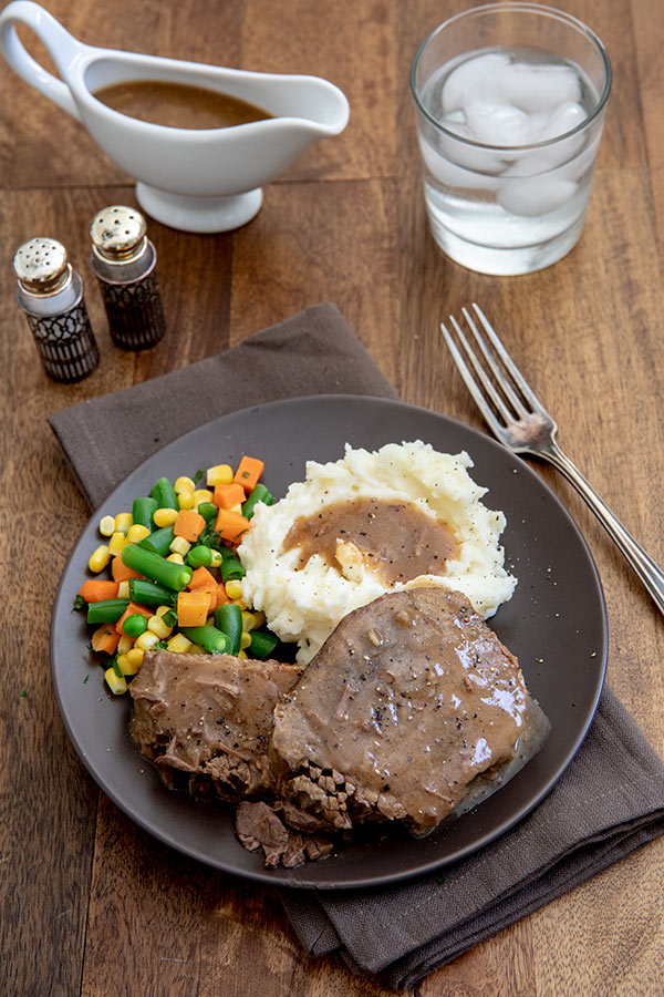 Round Steak and Gravy with Mashed Potatoes and Mixed Vegetables and extra gravy for serving