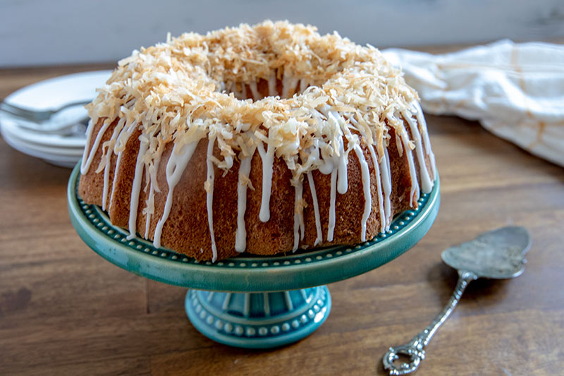 Coconut Bundt Cake on a blue cake stand