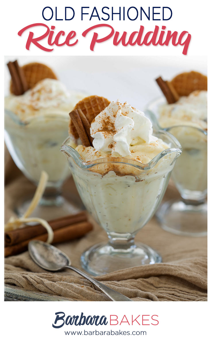 Close up on three glass goblets of homemade old-fashioned white rice pudding flavored with cinnamon and topped with whipped cream and waffle cookies.