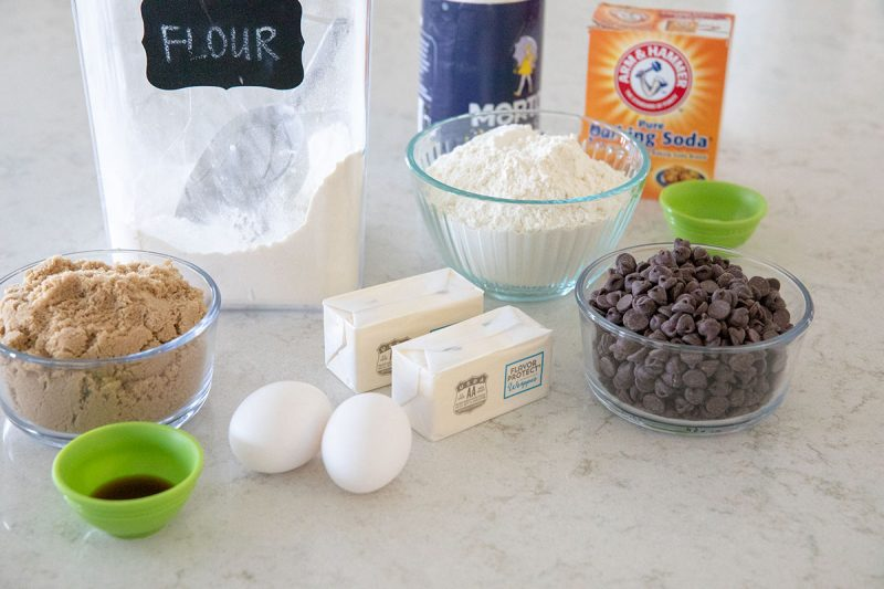 Ingredients for making thick and chewy chocolate chip cookies.