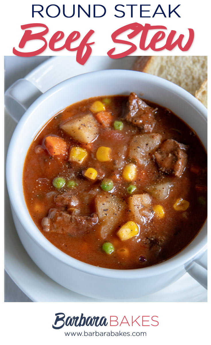 Round Steak Beef Stew with potatoes, carrots, peas, and corn in a white bowl