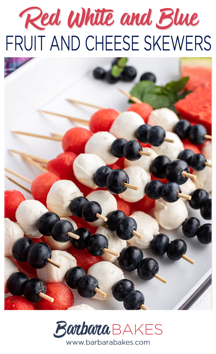 Close up of Red, White and Blue Fruit and Cheese skewers on a white platter