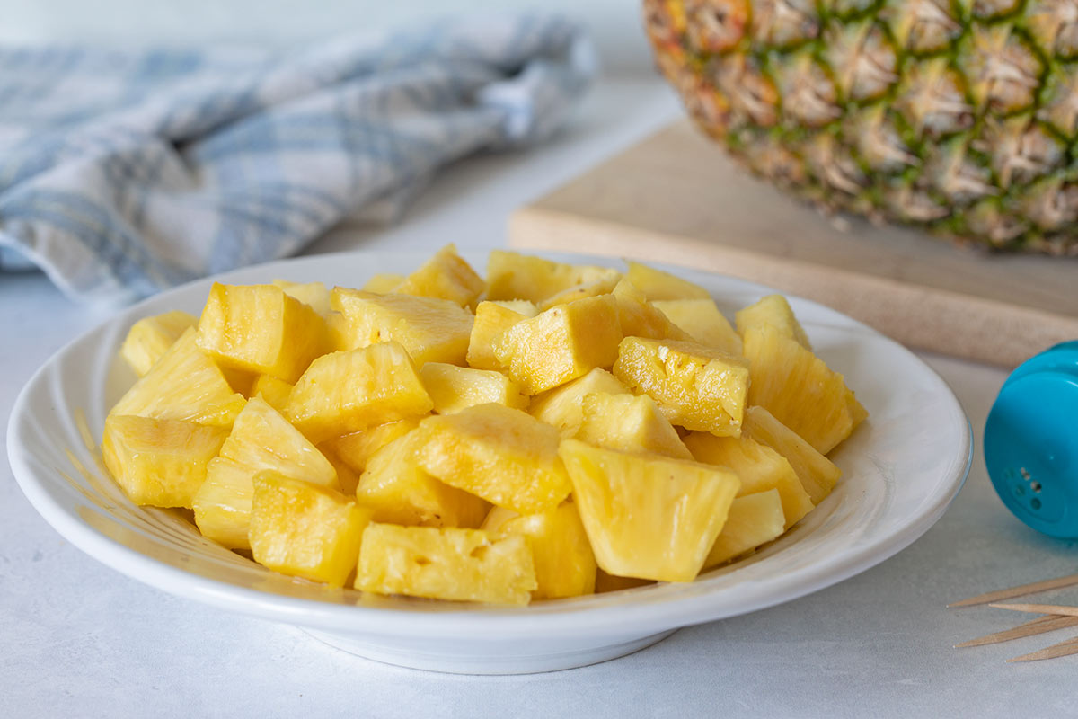 plate of pineapple cut into equal cubes