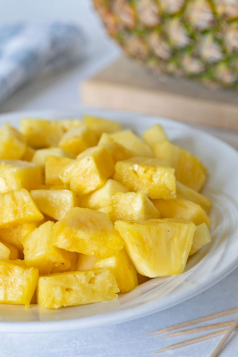 cubed pineapple cut without the skin on a white plate