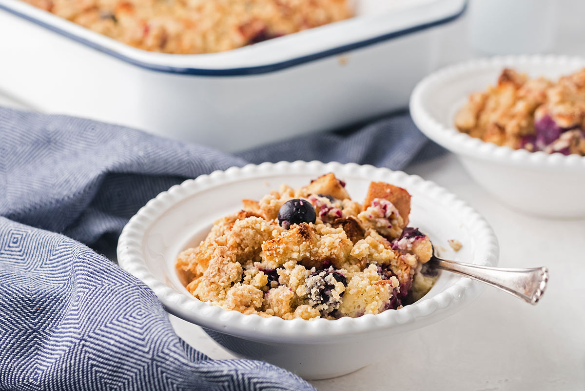 bowl of blueberry french toast bake in a small ceramic white bowl