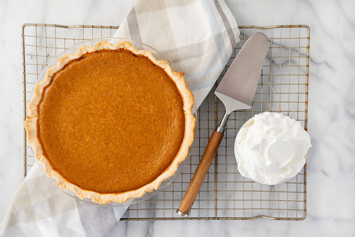 whole baked pumpkin pie on a cooling rack