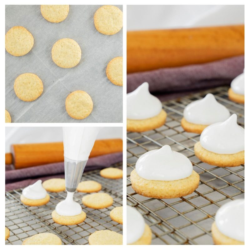 piping homemade marshmallows onto baked cookeis