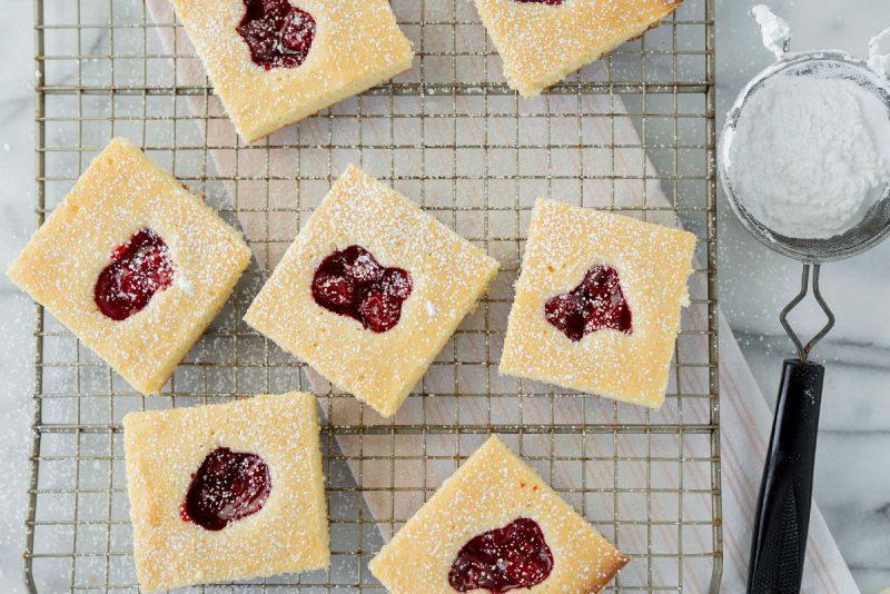 sliced cherry pie bars on a baking sheet