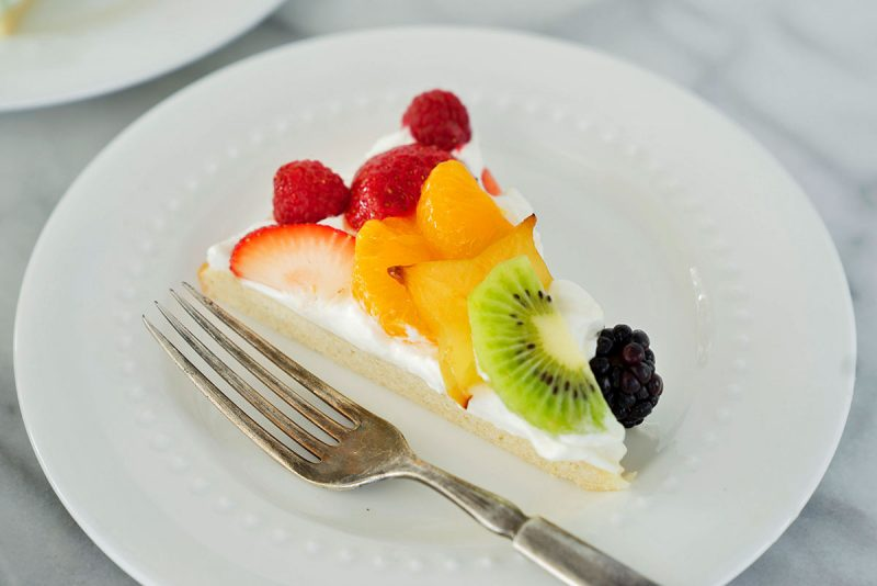 slice of fruit pizza on a white plate