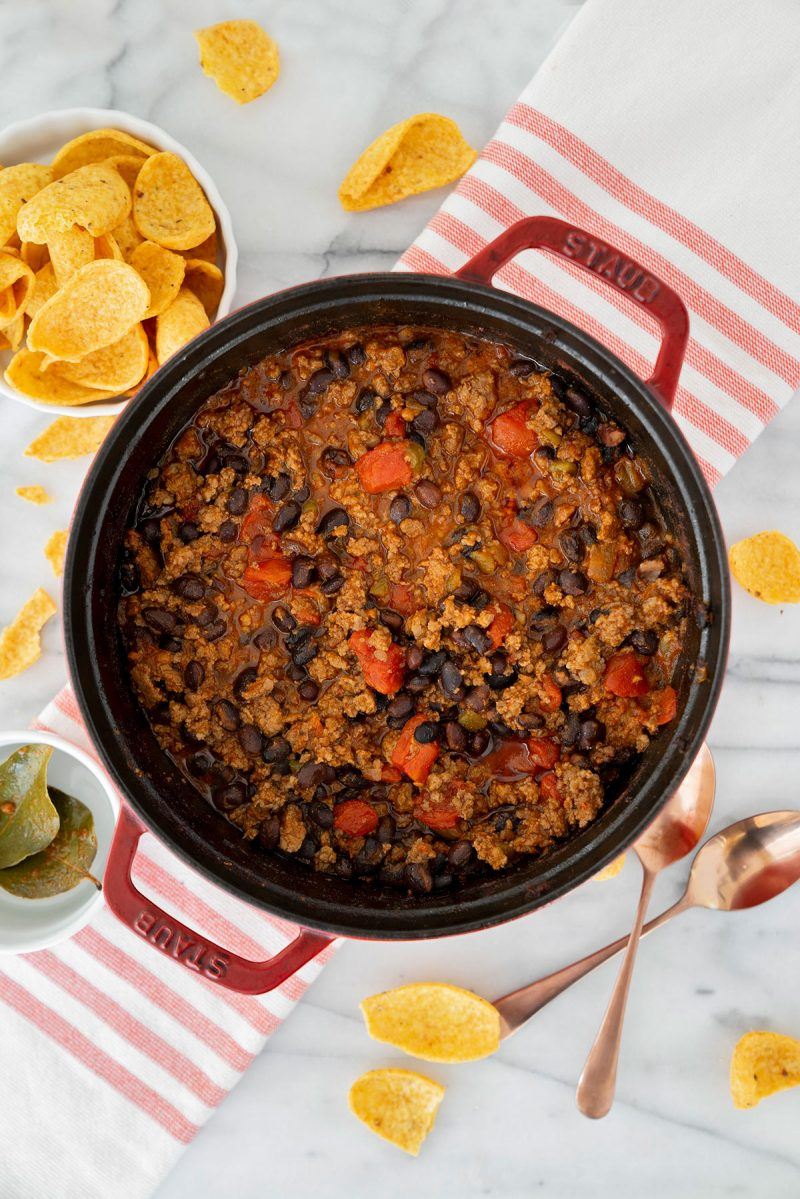 pot of oven baked chili with beef, sausage, tomatoes and beans