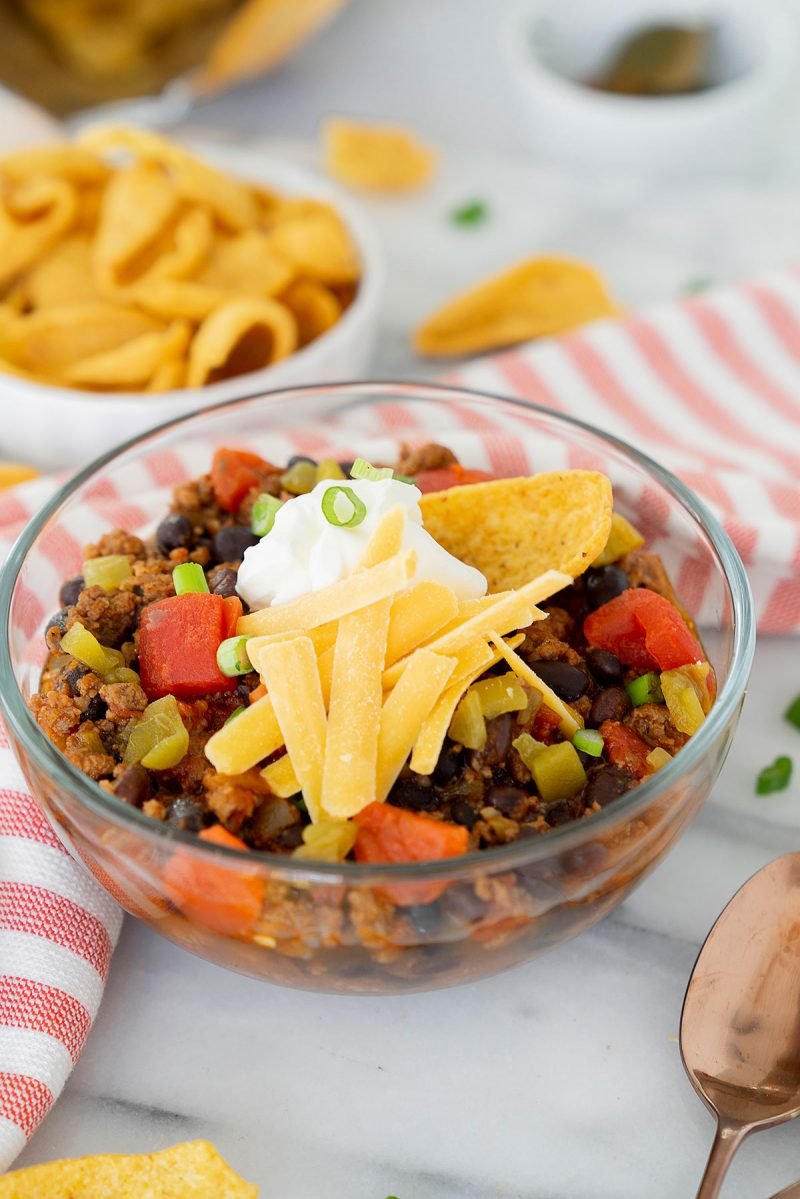 blow of thick chili with grated cheese and more toppings