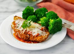 plat of light chicken parmesan with broccoli