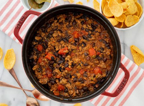 thick oven baked chili in cast iron pan