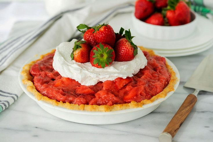 whole fresh strawberry pie with whipped cream