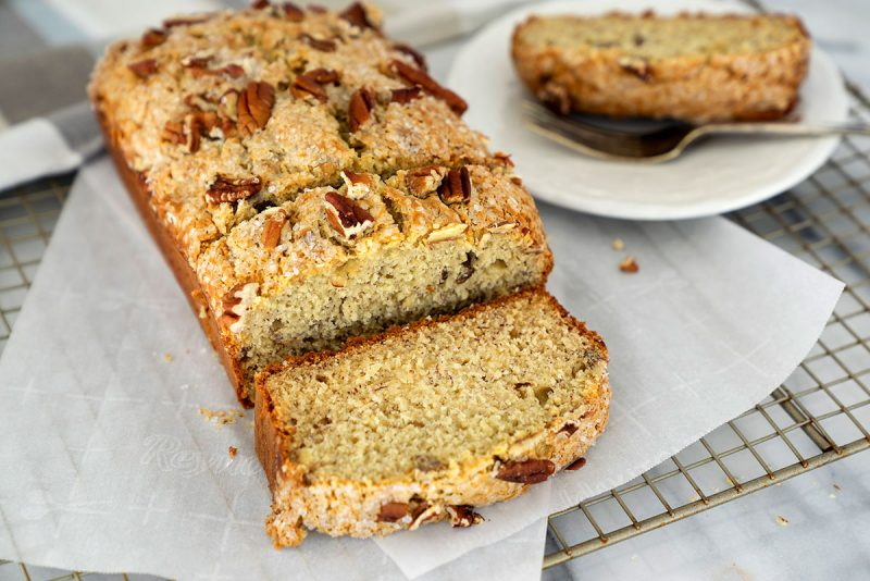 slices of easy banana bread with nuts on a wire rack