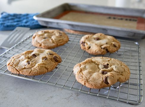 four air fryer chocoalte chip cookies on a wire rack