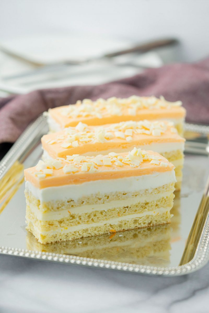 three slices of orange opera layer cake