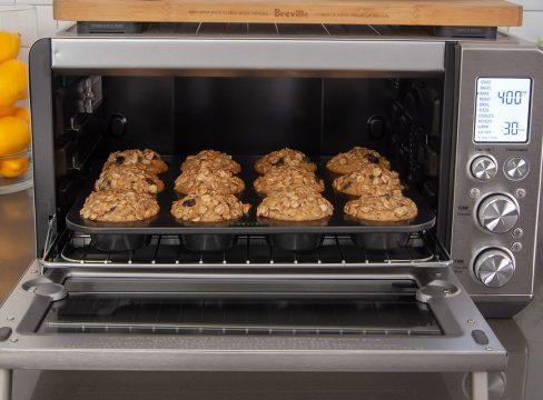 A dozen muffins baking in a Breville Smart Oven Air Fryer.