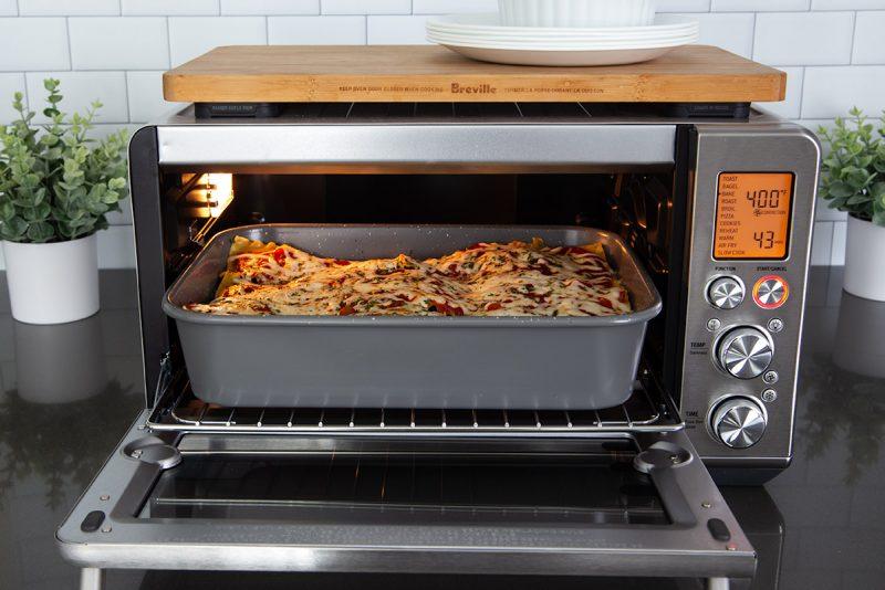 Lasagna baking in a Breville Smart Oven Air Fryer.
