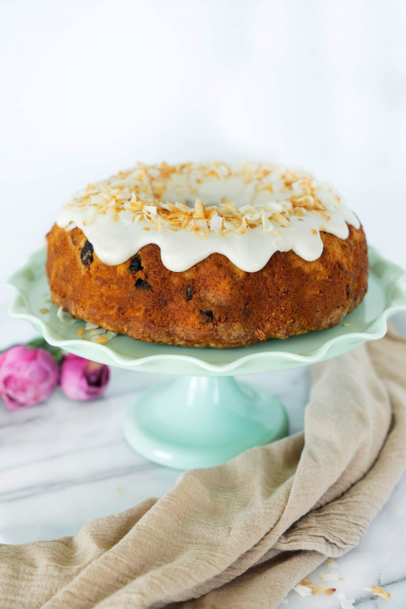 whole bundt cake with icing and toasted coconut