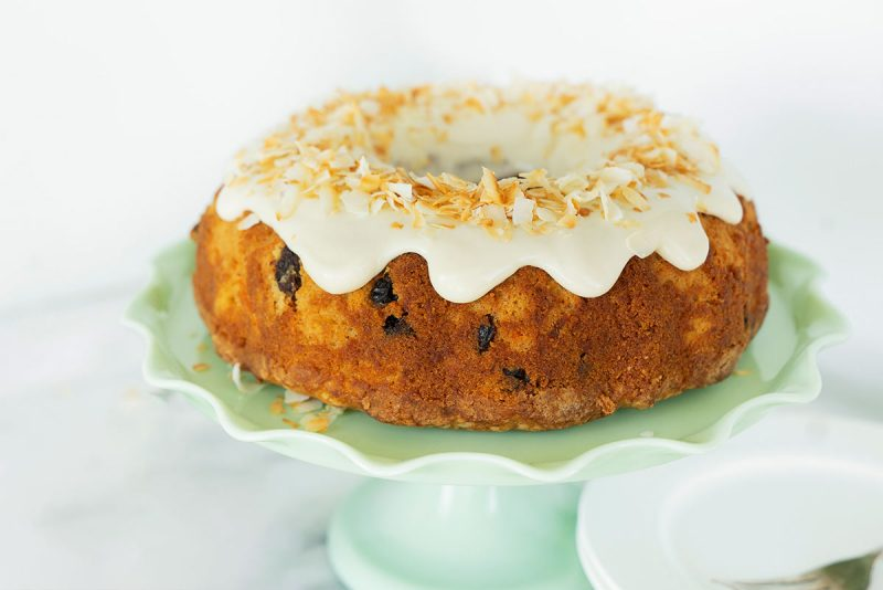 whole cake with cream cheese frosting and toasted coconut