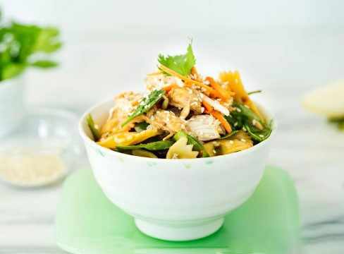 bowl of asian spinach and pasta salad