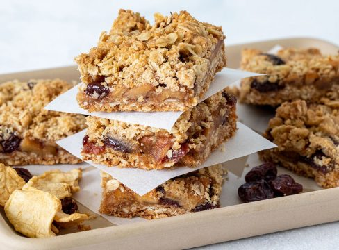 stack of bars with oats, apples, and cherries