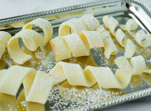 tuile cookies on a silver tray