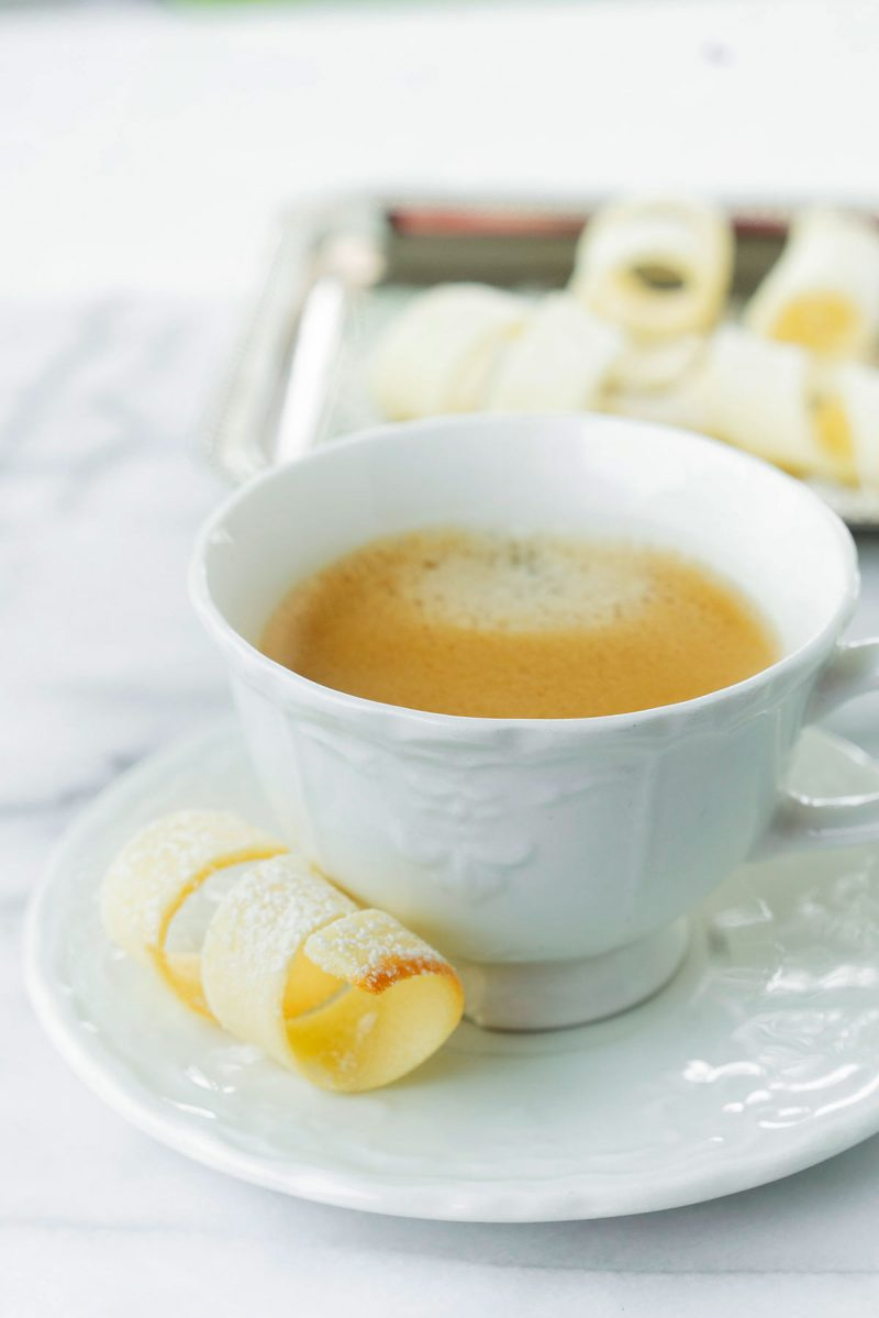 teacup with a tuile cookie on the side