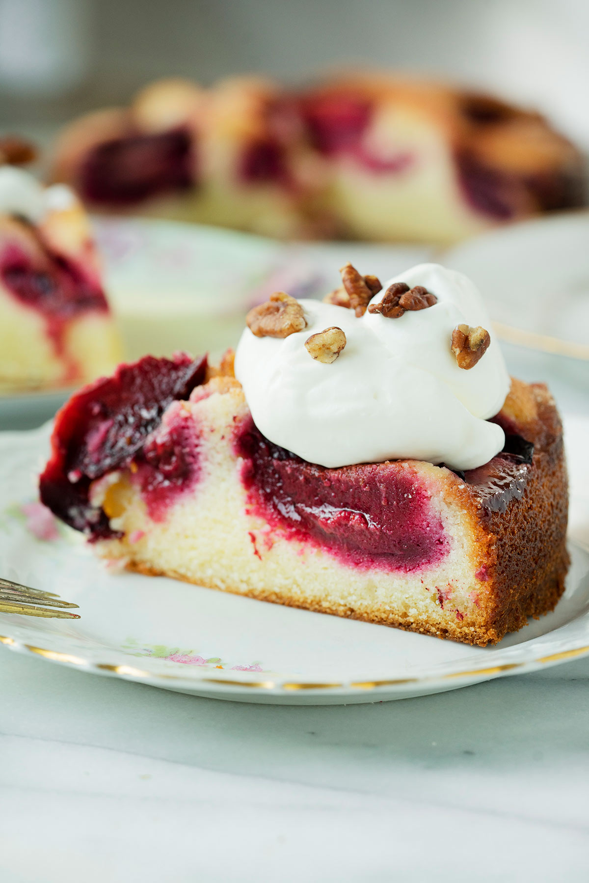 slice of plum cake with whipped cream