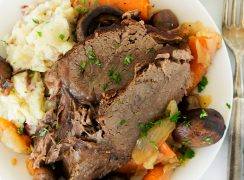 eye of round roast on a plate with mashed potatoes