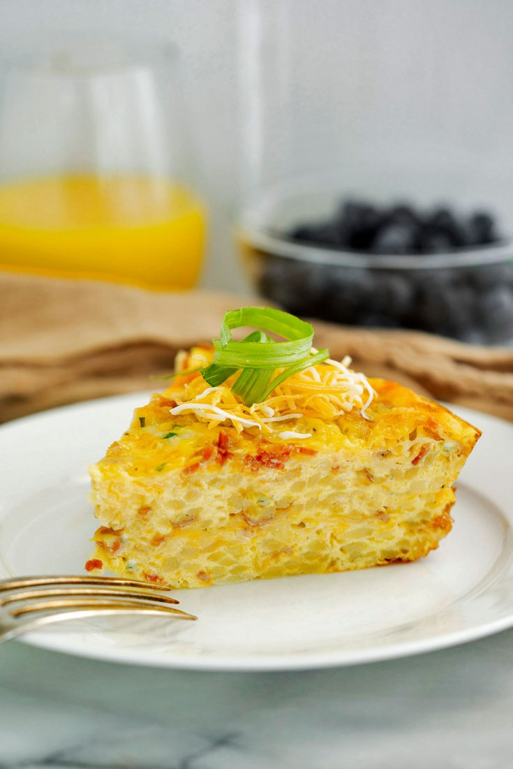 slice of hash brown quiche on a white plate