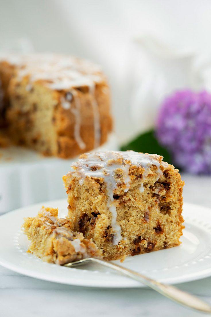 slice of snickerdoodle coffee cake with white glaze