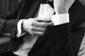 50241829-confident-man-buttons-cufflinks-cufflinks-closeup-men-s-suit-tuxedo-