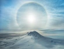 A Polar Sunbow Erupts Over an Iced Volcano (Antarctica)