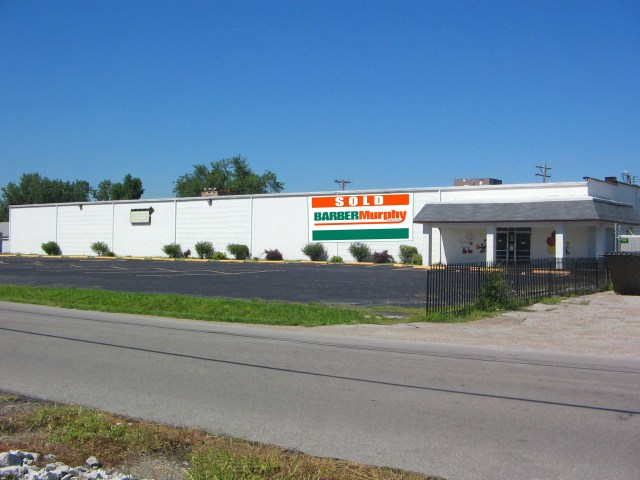 long white retail building sold in pontoon beach illinois