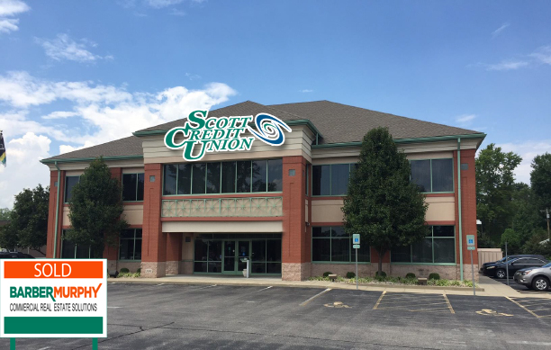 two story brick and tan building with green accents in belleville illinois purchased by scott credit union