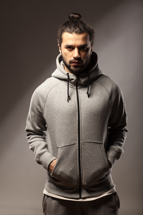 young man with beard and bun in tracksuits