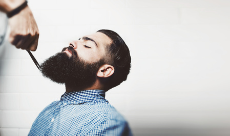 Mockup of bearded hipster in a barber shop