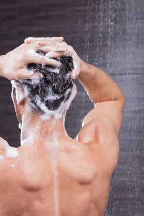 Handsome fit guy is cleaning his head